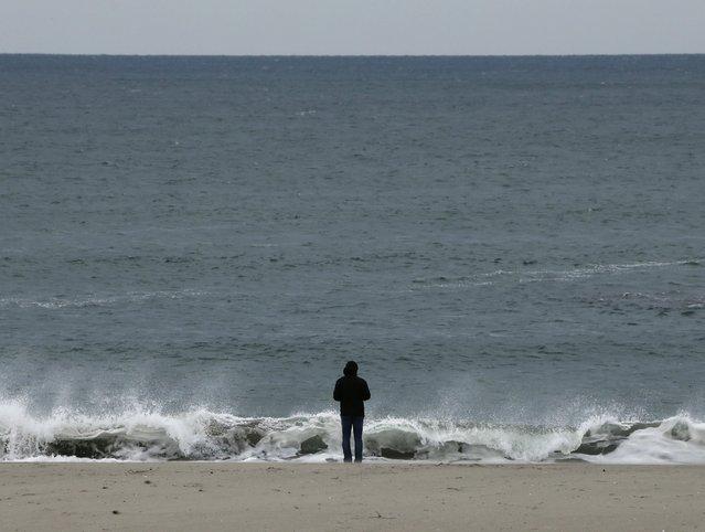A lone man stands on the sea shore at tsunami-devastated Arahama, in the coastal district of Sendai, Miyagi Prefecture, northern Japan, 10 March 2016. (Photo by Kimimasa Mayama/EPA)