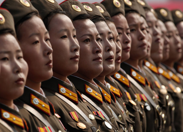 North Korean women soldiers march a massive military parade marking the 65th anniversary of the communist nation's ruling Workers' Party in Pyongyang, North Korea on Sunday, October 10, 2010. (Photo by Vincent Yu/AP Photo)