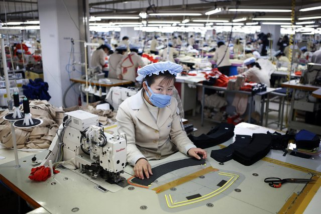 A North Korean employee works in a factory of a South Korean company at the Joint Industrial Park in Kaesong industrial zone, a few miles inside North Korea from the heavily fortified border in this December 19, 2013 file photo. (Photo by Kim Hong-Ji/Reuters)