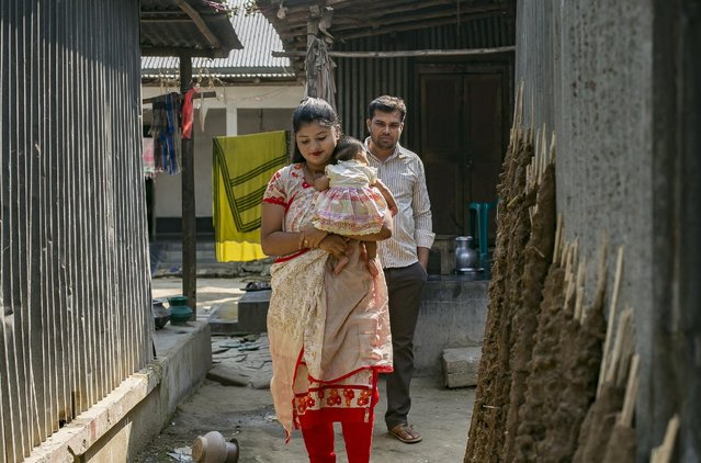 Meghla walks with her baby and her husband, Liton, on March 7, 2017 in Khulna division, Bangladesh. (Photo by Allison Joyce/Getty Images)