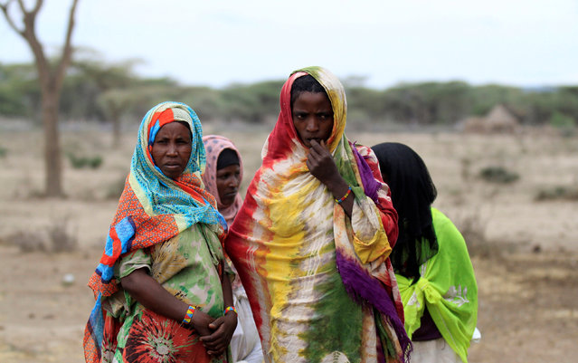 Women wait to receive supplementary food at a distribution centre in Gelcha village, one of the drought stricken areas of Oromia region, in Ethiopia, April 28, 2016. (Photo by Tiksa Negeri/Reuters)