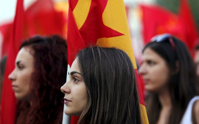 Supporters of the Greek Communist Party listen to a speech during a rally on Constitution (Syntagma) square, near the parliament building, in Athens, Greece, July 2, 2015. The International Monetary Fund delivered a stark warning on Thursday of the huge financial hole facing Greece as angry and uncertain voters prepare for a referendum that could decide their country's future in Europe. (Photo by Jean-Paul Pelissier/Reuters)