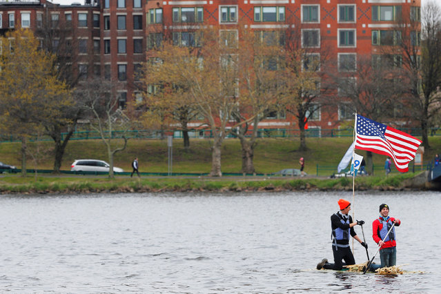 "Students paddle the ""Bamboo Crew Raft"" across the Charles River to Cambridge, Massachusetts, U.S. May 7, 2016 celebrating the 100th anniversary of the Massachusetts Institute of Technology's move from Boston across the Charles River to Cambridge. (Photo by Brian Snyder/Reuters)"