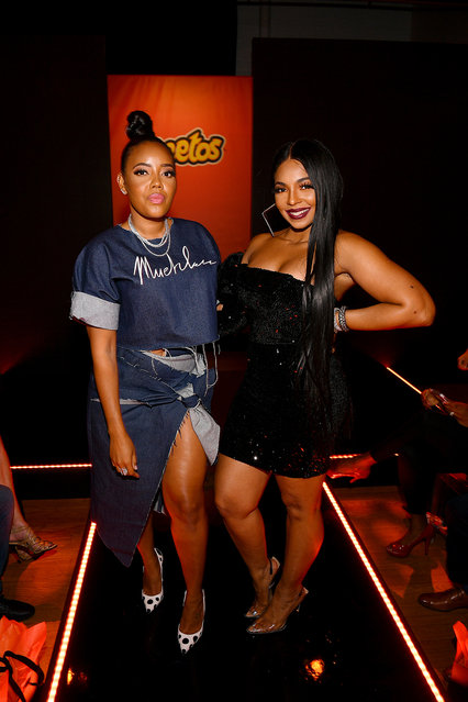 Angela Simmons and Ashanti attend as Cheetos unveiled fan-inspired versions of the #CheetosFlaminHaute look at The House Of Flamin' Haute Runway Show + Style Bar Experience during Fashion Week on September 05, 2019 in New York City. (Photo by Dave Kotinsky/Getty Images for Frito-Lay)