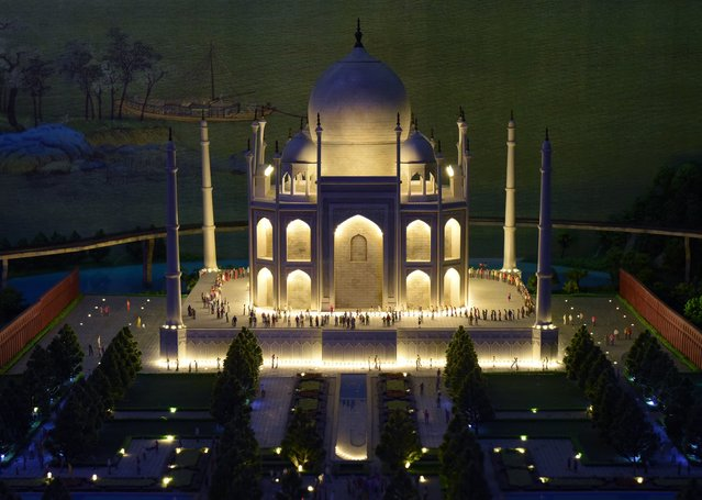 A miniature model of the Taj Mahal in Agra, India, part of Gulliver's Gate, a miniature world being recreated in a 49,000-square-foot exhibit space in Times Square, is seen during a preview April 10, 2017 in New York City. (Photo by Timothy A. Clary/AFP Photo)