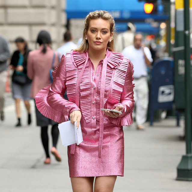"Actress Hilary Duff, wearing a pink ruffled dress, films ""Younger"" in New York, New York on April 17, 2017. (Photo by Christopher Peterson/Splash News and Pictures)"