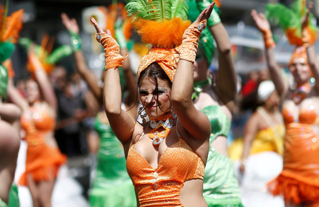 Dancers take part in the Karneval der Kulturen (Carnival of Cultures) street parade of ethnic minorities in Berlin, Germany, May 15, 2016. (Photo by Hannibal Hanschke/Reuters)