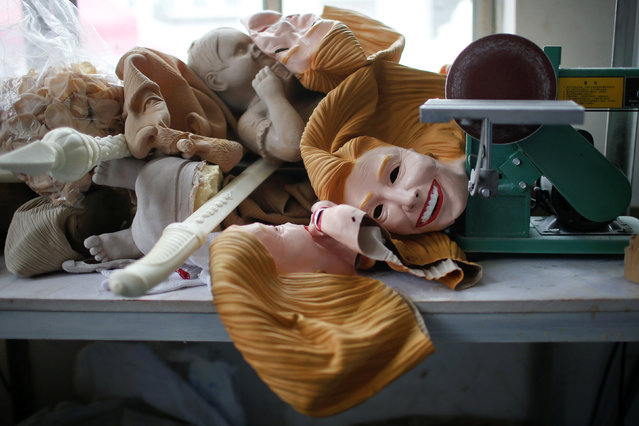 Masks, including some of U.S. Democratic presidential candidate Hillary Clinton, are seen at Jinhua Partytime Latex Art and Crafts Factory in Jinhua, Zhejiang Province, China, May 25, 2016. (Photo by Aly Song/Reuters)