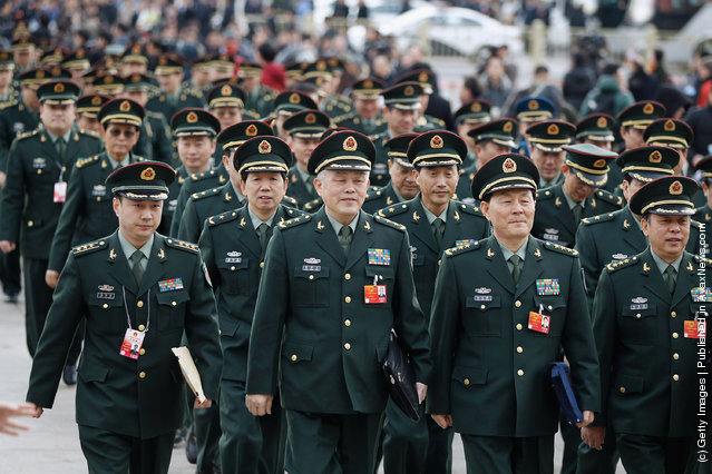 Chinese military delegates arrive at The Great Hall Of The People before the second plenary meeting of the National People's Congress (NPC)