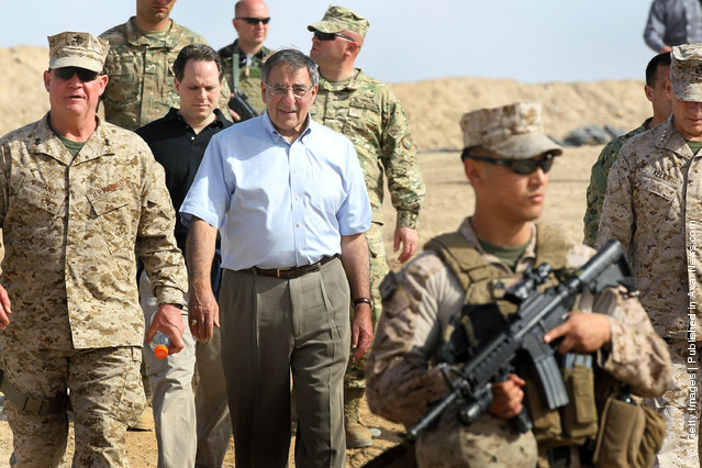 U.S. Secretary of Defense Leon Panetta leaves  after visiting with troops from the 31st BN Light Infantry of the Georgian Army March 14, 2012 at Foward Operating Base Shukvani, Afghanistan