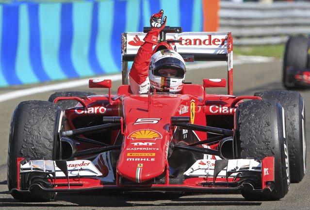 Winner Ferrari Formula One driver Sebastian Vettel of Germany celebrates after the Hungarian F1 Grand Prix at the Hungaroring circuit, near Budapest, Hungary July 26, 2015. (Photo by Bernadett Szabo/Reuters)