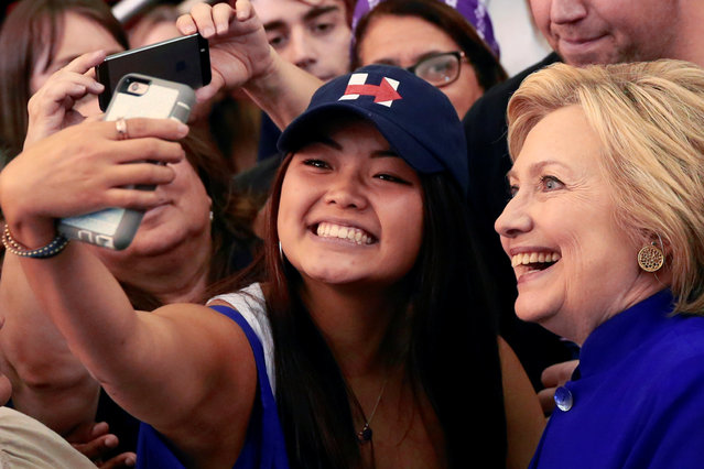 Democratic U.S. presidential candidate Hillary Clinton poses with supporters after a campaign event at Rutgers University's Newark campus in Newark, New Jersey, U.S., June 1, 2016. (Photo by Adrees Latif/Reuters)