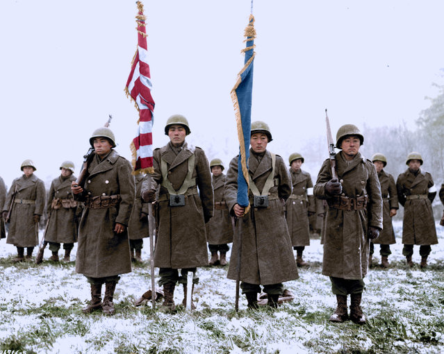 442nd Rct Color Bearers And Guards of the Japanese-American division stand to attention in the town of Bruyeres area in France in November 1944. (Photo by Jared Enos/Mediadrumworld.com)