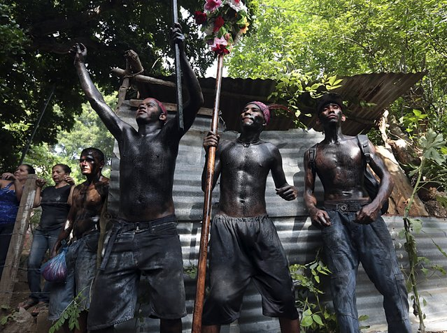 Devotees covered in motor oil take part in celebrations honoring the patron saint of Managua, Santo Domingo de Guzman, in Managua, Nicaragua, August 1, 2015. (Photo by Oswaldo Rivas/Reuters)