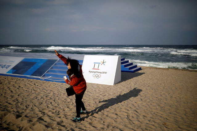 A woman plays on a beach as the symbol of the 2018 PyeongChang Winter Olympic Games is seen in Gangneung, South Korea February 9, 2017. (Photo by Kim Hong-Ji/Reuters)