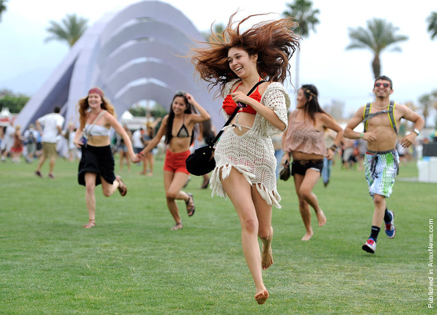 Festival goers run toward the main stage to catch the beginning of Kendrick Lamar's set during the first weekend of Coachella 2012, on April 13, 2012