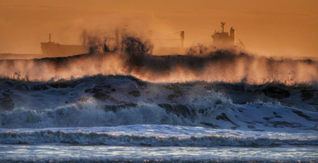 A cargo ship endures rough conditions in the North Sea near Tynemouth. England on March 17, 2019. (Photo by Owen Humphreys/PA Wire Press Association)