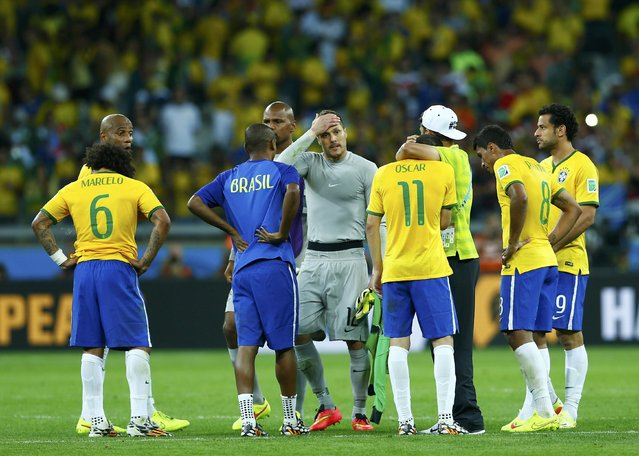Brazil players react after the 2014 World Cup semi-finals between Brazil and Germany at the Mineirao stadium in Belo Horizonte July 8, 2014. (Photo by Eddie Keogh/Reuters)