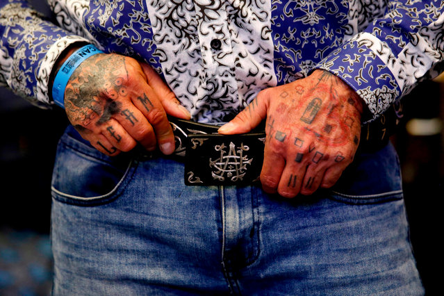 """A models poses wearing a belt by """"El Chapo 701"""", a line in clothing, jewelry and liquor bearing the nickname of the jailed Mexican drug lord Joaquin """"El Chapo"""" Guzman Loera, during the 72 edition of IM Intermoda Mexico fashion fair in Guadalajara, Mexico, on January 14, 2020. (Photo by Ulises Ruiz/AFP Photo)"""