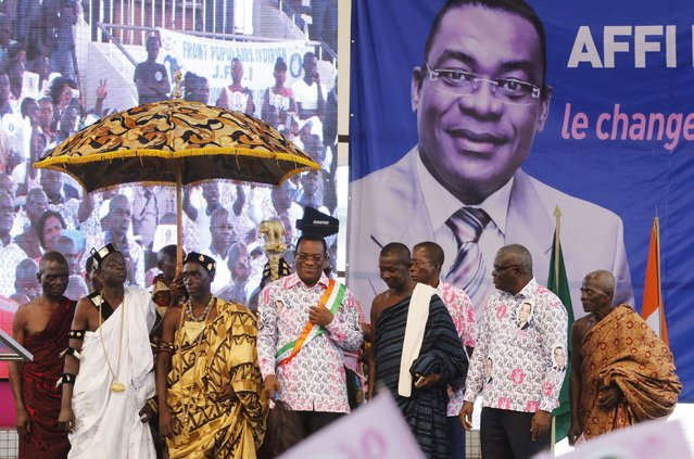 Pascal Affi N'Guessan of the Ivorian Popular Front (FPI) party poses for pictures with chiefs after a ceremony for his official inauguration as a presidential candidate for Ivory Coast's upcoming presidential election, at the Culture Palace of Abidjan in Treichville, August 8, 2015. FPI, the party of Ivory Coast's ex-president Laurent Gbagbo, has chosen its leader, Pascal Affi N'Guessan, to run in the Oct. 25 presidential election that will mark its return to electoral politics following a string of boycotts since a brief 2011 war. (Photo by Thierry Gouegnon/Reuters)