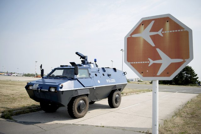 An armored car of the German Federal Police is seen during a security drill at Schoenefeld airport near Berlin, Germany August 12, 2015. (Photo by Stefanie Loos/Reuters)