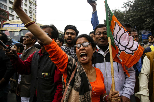 Supporters and leaders of India's ruling Bharatiya Janata Party (BJP) shout slogans during a rally supporting a new citizenship law that opponents say threatens India's secular identity, in Kolkata, India, Friday, February 7, 2020. The law provides a fast-track to naturalization for persecuted religious minorities from some neighboring Islamic countries, but excludes Muslims. (Photo by Bikas Das/AP Photo)