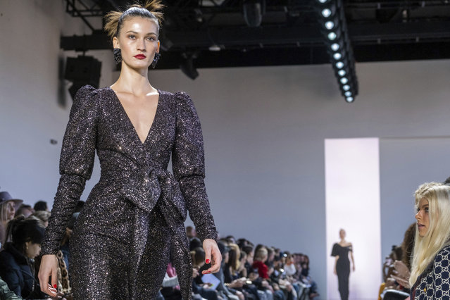 The Badgley Mischka collection is modeled at Spring Studios during NYFW Fall/Winter 2020 on Saturday, February 8, 2020, in New York. (Photo by Charles Sykes/Invision/AP Photo)