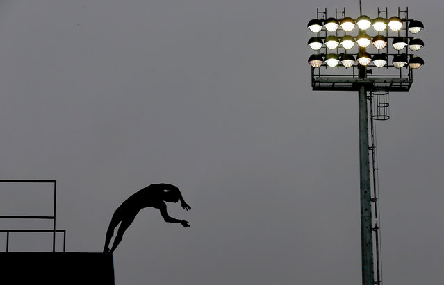 Chen Aisen of China competes in the team event of the 19th FINA Diving World Cup at the Oriental Sports Center on July 15, 2014 in Shanghai, China. (Photo by Lintao Zhang/Getty Images)