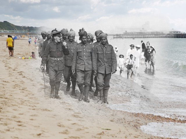 Wounded Indian soldiers are seen recuperating on the beach in Bournemouth in 1917, digitally altered against an image from 2014, also showing people walking along the same beach. (Photo by Peter Macdiarmid/Getty Images)