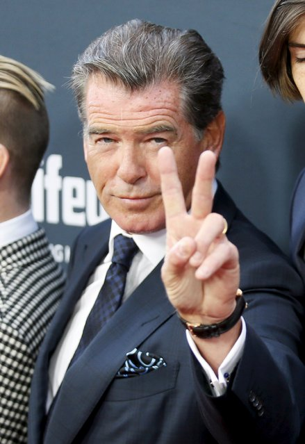 """Cast member Pierce Brosnan poses at the premiere of the film """"No Escape"""" in Los Angeles, California August 17, 2015. (Photo by Danny Moloshok/Reuters)"""