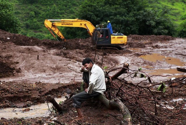 Chandrakant Zanjare, who said he lost 13 family members in the landslide, wails near the site where his house stood in Malin village, in the western Indian state of Maharashtra, on August 1, 2014. (Photo by Rafiq Maqbool/Associated Press)