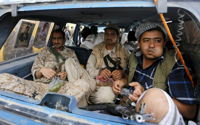 Houthi militants sit in a vehicle as they secure an area where fellow Houthis demonstrated against the Saudi-led air strikes in Yemen's capital Sanaa August 24, 2015. (Photo by Khaled Abdullah/Reuters)