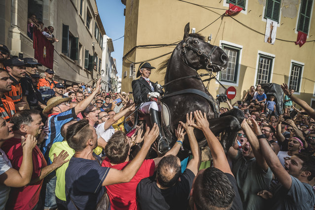 """A """"caixer"""" or horse rider rears up on her horse as they parade through the city prior to the """"Jaleo"""" of the traditional Gracia Festival in Mahon, Spain celebrating its patron, Our Lady of Grace on September 7, 2017. (Photo by Matthias Oesterle/ZUMA Wire/Rex Features/Shutterstock)"""