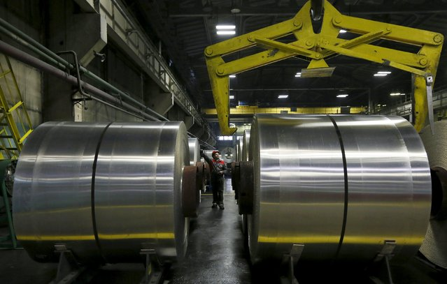 An employee works on rolls of aluminum foil in a shop of the Rusal's SAYANAL foil mill outside the town of Sayanogorsk, Russia, September 3, 2015. (Photo by Ilya Naymushin/Reuters)