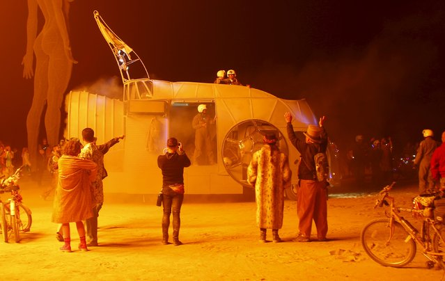 """A mutant vehicle makes it way across the Playa during the Burning Man 2015 """"Carnival of Mirrors"""" arts and music festival in the Black Rock Desert of Nevada, September 3, 2015. (Photo by Jim Urquhart/Reuters)"""