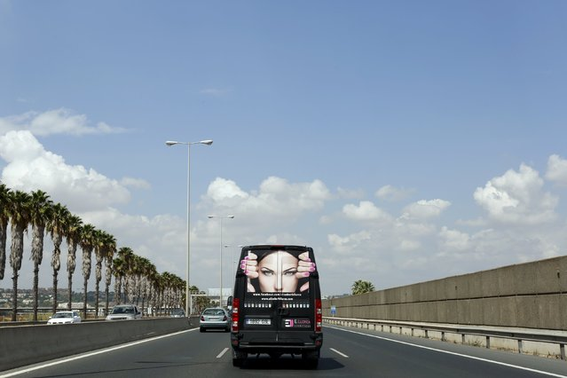 A van of a cosmetic company is pictured as it is driven along a ring road in the Andalusian capital of Seville, southern Spain, September 7, 2015. (Photo by Marcelo del Pozo/Reuters)