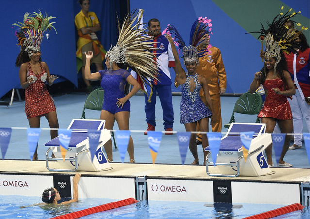 Samba dancers perform prior to the evening session of the swimming competitions at the 2016 Summer Olympics, Saturday, August 6, 2016, in Rio de Janeiro, Brazil. (Photo by Martin Meissner/AP Photo)