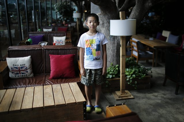 "Only child Qian Dingheng, who was born in 2005, poses for a photograph in Shanghai August 30, 2014. ""I don't want (a sibling), because he would interrupt my homework"", Dingheng said. (Photo by Carlos Barria/Reuters)"