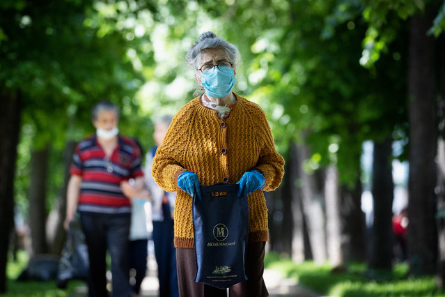 A woman in a face mask and gloves in Chistoprudny Boulevard during a national holiday known as Russia Day, celebrated on 12 June, amid the pandemic of the novel coronavirus disease (COVID-19). On 9 June, Moscows authorities lifted the lockdown, however wearing face masks and observing social distancing rules in public remains mandatory. As of 12 June 2020, Russia has reported more than 511,000 confirmed cases of the novel coronavirus infection, with more than 202,000 confirmed cases in Moscow. (Photo by Stanislav Krasilnikov/TASS via Getty Images)