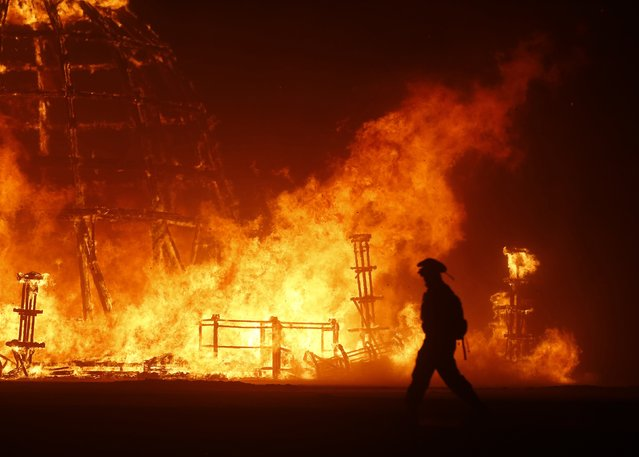 """The Temple of Grace burns on the last day of the Burning Man 2014 """"Caravansary"""" arts and music festival in the Black Rock Desert of Nevada, August 31, 2014. (Photo by Jim Urquhart/Reuters)"""