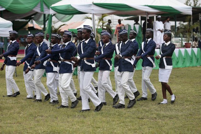 Members of the Boy's Brigade march in a parade at the Old Parade ground during celebrations to commemorate Nigeria's 55th Independence Day in Abuja, Nigeria, October 1, 2015. (Photo by Afolabi Sotunde/Reuters)