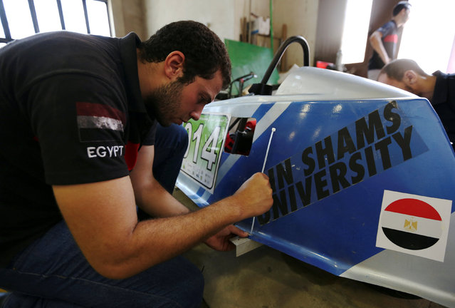 An Egyptian university student works on a hybrid racing car to compete at the Egypt's Global Hybrid-Electric Challenge in Cairo, Egypt September 2, 2016. (Photo by Mohamed Abd El Ghany/Reuters)
