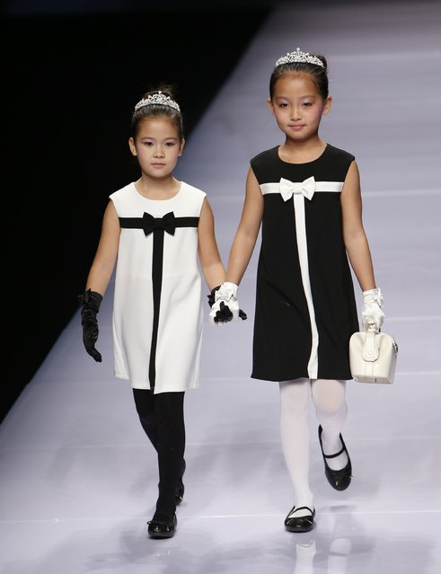 Child models present creations at the Dong Wenmei T100 Children's Collection during China Fashion Week in Beijing October 29, 2014. (Photo by Kim Kyung-Hoon/Reuters)