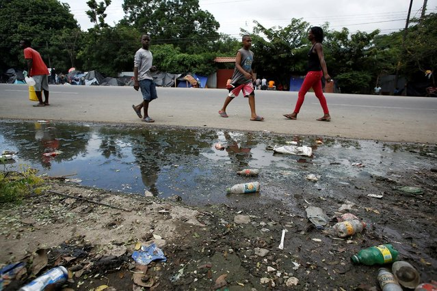 African migrants stranded in Costa Rica walk near garbage on the Inter-American highway in the border between Costa Rica and Nicaragua, in Penas Blancas, Costa Rica, September 7, 2016. (Photo by Juan Carlos Ulate/Reuters)