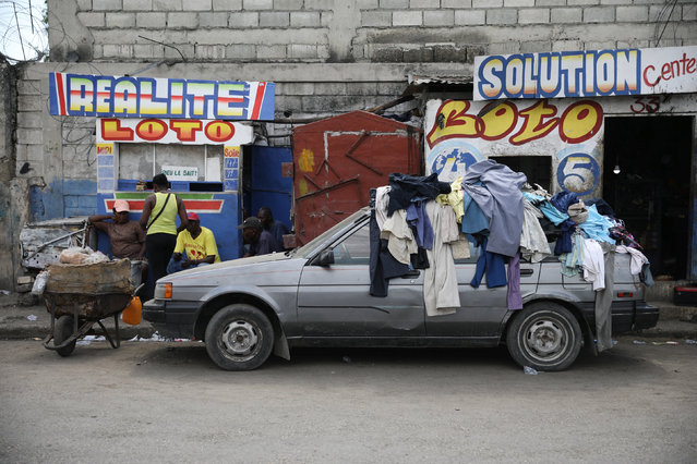 Clothes on display for sale lie on a car parked in a street of Port-au-Prince, Haiti, June 2, 2017. (Photo by Andres Martinez Casares/Reuters)