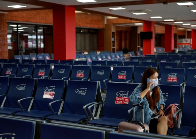 A passenger waits to board her flight at Tribhuvan International Airport, which reopened for limited international flights, in Kathmandu, Nepal, on September  2, 2020. Nepal's government reopened the airport, allowing a limited number of chartered and scheduled passenger flights. (Photo by Navesh Chitrakar/Reuters)