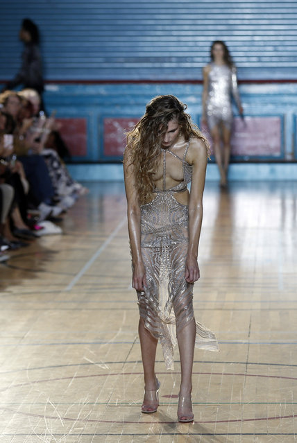 A model adjusts a creation by designer Julien Macdonald during his Spring/Summer 2017 runway show at London Fashion Week in London, Saturday, September 17, 2016. (Photo by Alastair Grant/AP Photo)
