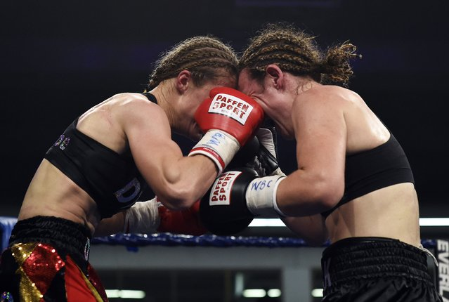 Belgium's Delfine Persoon (L) fights against Australia's Diana Prazak during the women's lightweight World Cup final boxing match of the WBC Mediterranean Championship in Wingene in the discrict of Zwevezele on November 11, 2014. (Photo by John Thys/AFP Photo)