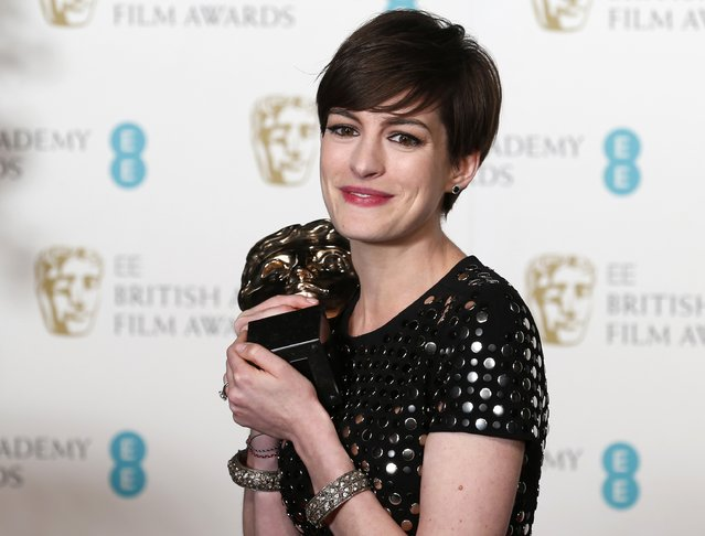 """Anne Hathaway celebrates after winning the Best Supporting Actress award for """"Les Miserables"""" at the British Academy of Film and Arts (BAFTA) awards ceremony at the Royal Opera House in London February 10, 2013. (Photo by Suzanne Plunkett/Reuters)"""