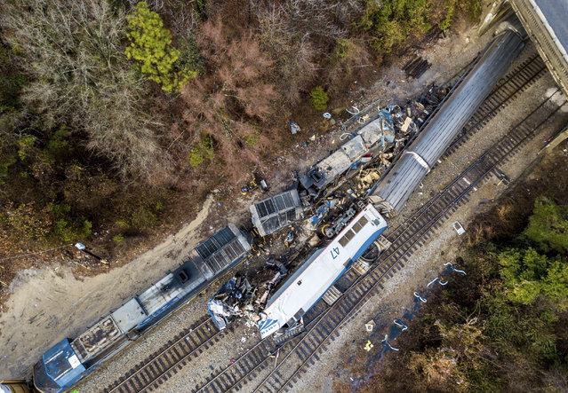 An aerial view of the site of an early morning train crash Sunday, February 4, 2018 between an Amtrak train, bottom right, and a CSX freight train, top left, in Cayce, SC. The Amtrak passenger train slammed into a freight train in the early morning darkness Sunday, killing at least two Amtrak crew members and injuring more than 110 people, authorities said. (Photo by Jeff Blake/AP Photo)